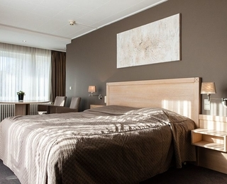 slaapkamer Hotel les Arcades