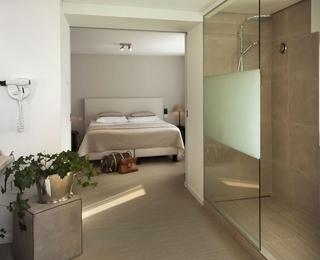 slaapkamer Hotel Lugano