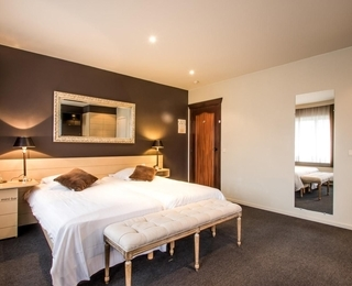 slaapkamer Paul's Hotel